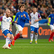 PARIS, FRANCE - March 25:  Aron Gunnarsson #17 of Iceland in action defended by Antoine Griezmann #7 of France during the France V Iceland, 2020 European Championship Qualifying, Group Stage at  Stade de France on March 25th 2019 in Paris, France (Photo by Tim Clayton/Corbis via Getty Images)