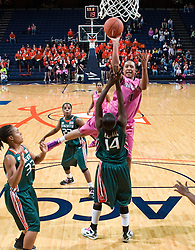 Virginia forward Lyndra Littles (1) shoots a jump shot over Miami (FL) guard/forward Charmaine Clark (14).  The #21 ranked Virginia Cavaliers defeated the Miami Hurricanes 85-74 in overtime at the John Paul Jones Arena in Charlottesville, VA on February 19, 2009.