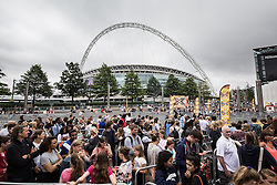© Licensed to London News Pictures. 20/07/2015. London, UK. Contestants and audience members queue outside the SSE arena in Wembley for X Factor auditions. Photo credit : James Gourley/LNP