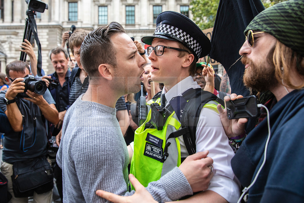 © Licensed to London News Pictures. 31/08/2019. London, UK. A far-right pro-Brexit activist clashes with police as thousands of protesters gather outside Downing Street to protest against the suspension of Parliament. The Queen has approved Prime Minister Boris Johnson's request to prorogue Parliament shortly after MPs return to work in September, a few weeks before the Brexit deadline of 31 October. Photo credit: Rob Pinney/LNP
