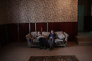 Petrea (11) and Dima (10), in one of the common rooms of Straseni's orphanage, Republic of Moldova. In this orphanage, as well as in many others, only 20% of children have lost their parents. The remaining 80% have their fathers or mothers alive, that can't take care of them, for social, economic or legal reasons. In many cases, the parents can't take care of them, because they are working abroad.