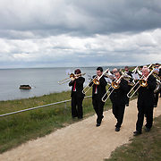 A REQUIEM FOR THE FOGHORN, PERFORMED BY SEVENTY FIVE BRASS PLAYERS, A FOGHORN AND AN ARMADA OF SHIPS<br />