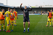 Ashley Bayes Wimbledon Goalkeeping Coach applauds the fans at full time during the EFL Sky Bet League 1 match between Scunthorpe United and AFC Wimbledon at Glanford Park, Scunthorpe, England on 30 March 2019.