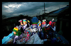 Feb 23rd, 2006. New Orleans, Louisiana. The Krewe of Muses. Muses is the only all women's Krewe to parade in New Orleans and is known for its satire, famous shoe throws and is generally considered one of the most popular parades of the Mardi Gras. Women load up on their floats ready for the parade hanging beads on hooks, (including their famous glitter shoes) preparing the float ready to roll.