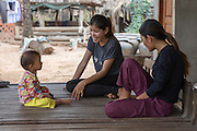 ICS volunteer Sokuntheary Nhel entertaining the children and chatting with the family in her host home, in the village of in Banteay Char, near Battambang, Cambodia.