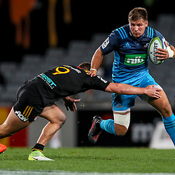 Piers Francis of the Blues makes a break during the Super Rugby Match between the Blues and the Chiefs at Eden Park in Auckland, New Zealand on Friday 26  May 2017. Photo: Simon Watts / www.lintottphoto.co.nz