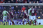 Don Cowie gets a touch on Christophe Berra's header to score goal in the William Hill Scottish Cup 4th round match between Heart of Midlothian and Hibernian at Tynecastle Stadium, Gorgie, Scotland on 21 January 2018. Photo by Kevin Murray.