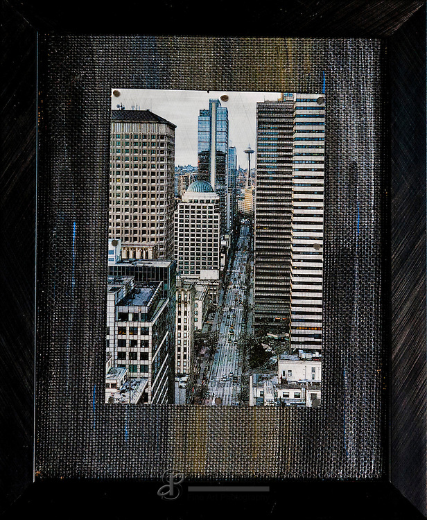 "Price $90, Second Avenue is printed on one up-cycled aluminum can mounted on a 8""x 10"" hand painted background and framed."
