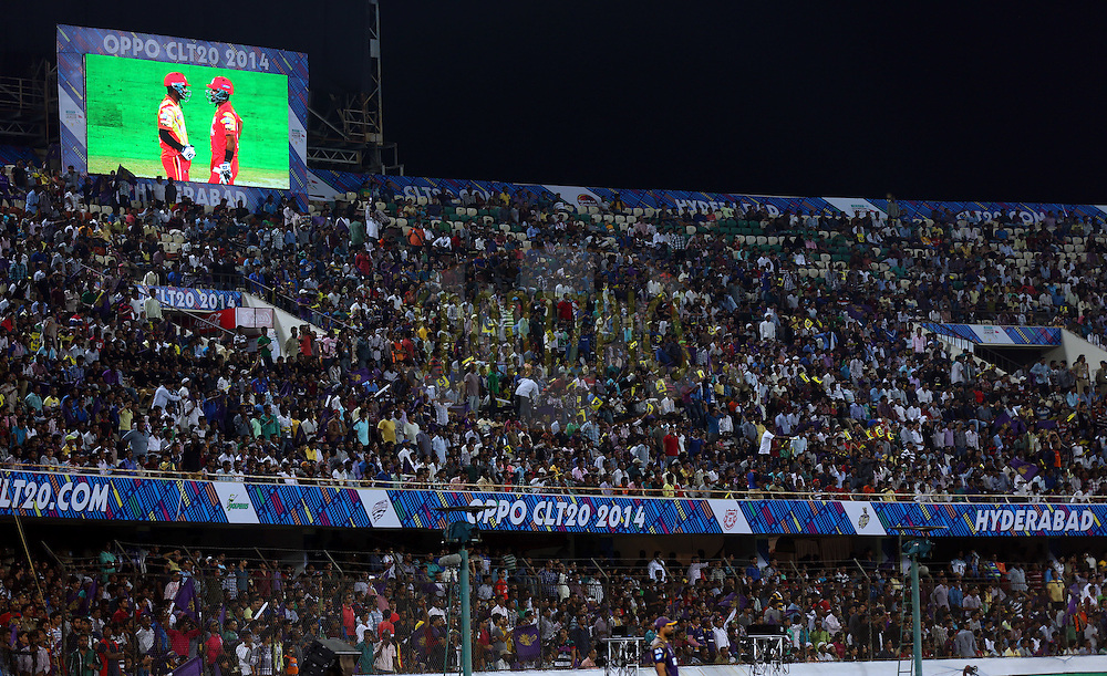 Crowd during match 7 of the Oppo Champions League Twenty20 between the Kolkata Knight Riders and the Lahore Lions held at the Rajiv Gandhi Cricket Stadium, Hyderabad, India on the 21st September 2014<br /> <br /> Photo by:  Sandeep Shetty / Sportzpics/ CLT20<br /> <br /> <br /> Image use is subject to the terms and conditions as laid out by the BCCI/ CLT20.  The terms and conditions can be downloaded here:<br /> <br /> http://sportzpics.photoshelter.com/gallery/CLT20-Image-Terms-and-Conditions-2014/G0000IfNJn535VPU/C0000QhhKadWcjYs