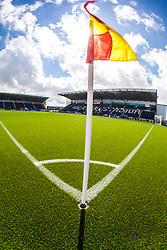 An upright image with sunlight caught in the corner flag,with the main stand behind. The Falkirk Stadium, with the new pitch work for the Scottish Championship game v Morton. The woven GreenFields MX synthetic turf and the surface has been specifically designed for football with 50mm tufts compared with the longer 65mm which has been used for mixed football and rugby uses.  It is fully FFA two star compliant and conforms to rules laid out by the SPL and SFL.<br /> &copy;Michael Schofield.