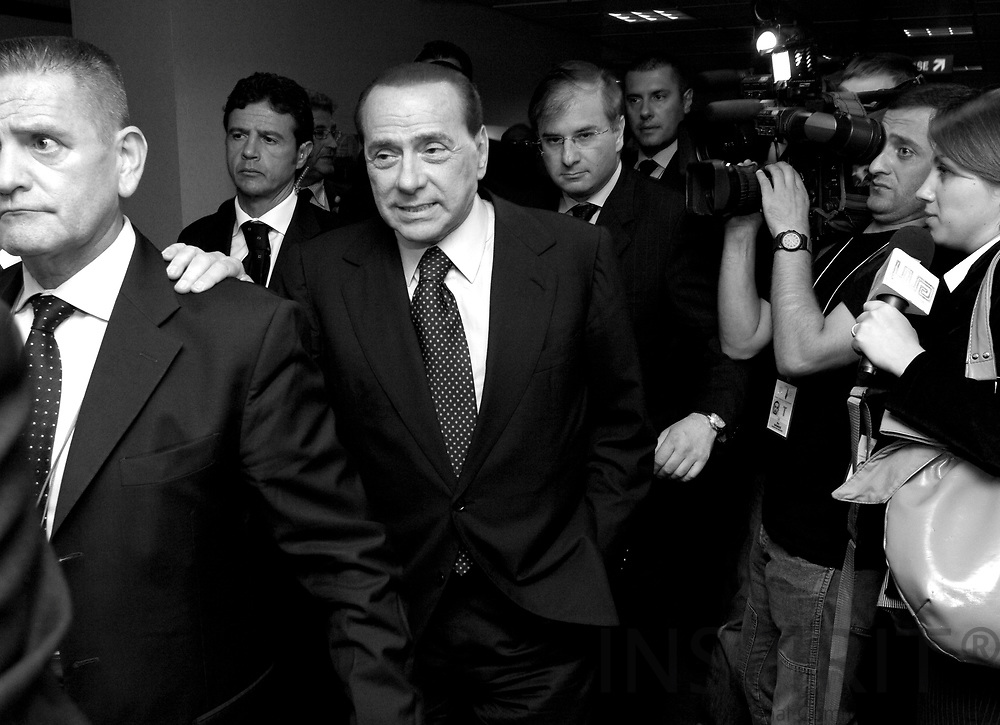 BRUSSELS - BELGIUM - 01 SEPTEMBER 2008 -- Extraordinary EU Summit on Georgia -- The Italian Prime Minister Silvio BERLUSCONI leaves the summit surrounded by bodyguards and civil servants while a TV grew films him. -- Photo: Erik LUNTANG