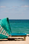 Beach chair cabanas by the sea.
