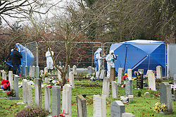 © London News Pictures. 18/12/2013 . Didcot, UK. A Police forensics team taking pictures and examining an area in a graveyard at All Saints Church in Dicot where police have started searching in connection with the disappearance of teenager Jayden Parkinson who has been missing since December 3rd. 22 year-old Ben Blakeley has been charged with the murder of 17-year-old Jayden. Photo credit : Ben Cawthra/LNP