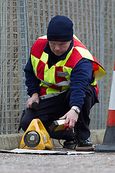 © Licensed to London News Pictures . 14/03/2013 . Rochdale , UK . Specialist investigators from Greater Manchester Fire and Rescue examine a suspicious device found at The Point Retail Park in Rochdale  using a device used to measure radiation levels . The retail park was evacuated this afternoon (14th March) following the discovery . Police say the discovery is a radioactive canister stolen from a van in Bacup last month . Photo credit : Joel Goodman/LNP