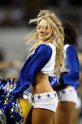 A Dallas Cowboys cheerleader performs during a time out against the Pittsburgh Steelers at Cowboys Stadium in Arlington, Texas, on December 16, 2012.  (Stan Olszewski/The Dallas Morning News)