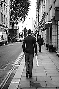 Man in a hat on London's Jermyn Street
