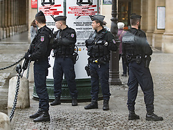 © Licensed to London News Pictures . 06/05/2017 . Paris , France . Armed police outside the Louvre , which is closed following a security alert . The electorate are voting in the final round of the French election today (7th May 2017) . Emmanuel Macron's En Marche and Marine Le Pen's Front National are competing for the Presidency . Photo credit: Joel Goodman/LNP