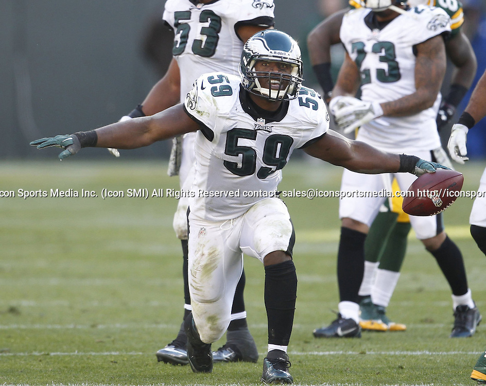 Nov. 10, 2013 - Green Bay, WI, USA - DeMeco Ryans of the Philadelphia Eagles celebrates intercepting a pass against the Green Bay Packers at Lambeau Field in Green Bay, Wis., on Sunday, Nov. 10, 2013. The Eagles beat the Packers, 27-13