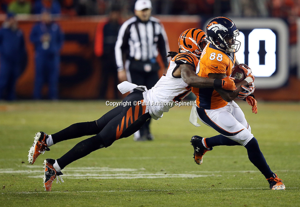 Denver Broncos wide receiver Demaryius Thomas (88) gets tackled by diving Cincinnati Bengals cornerback Dre Kirkpatrick (27) after catching a third quarter pass for a gain of 7 yards during the 2015 NFL week 16 regular season football game against the Cincinnati Bengals on Monday, Dec. 28, 2015 in Denver. The Broncos won the game in overtime 20-17. (©Paul Anthony Spinelli)
