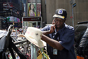5 May 2010- New York, New York- Duane Jackson another of the Unsung Heroes of Times Square Bombing Attempt sigining American Flag for Visitors at the corner of West 45th and Seventh Avenue in front of Viacom Building on May 5, 2010 in New York City.