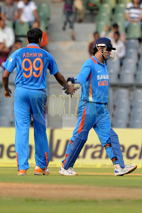 Mahendra Singh Dhoni captain of India celebrate a wicket during the 4th One Day International ( ODI ) match between India and England held at the Wankhede Stadium, Mumbai on the 23rd October 2011..Photo by Pal Pillai/BCCI/SPORTZPICS