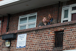 Chuka Umunna MP for Streatham and Shadow Secretary of State for Business, Innovation and Skills, With resident Michelle Martin on Tulse Hill Estate, London, UK, 24 February, 2013. Photo by i-Images...