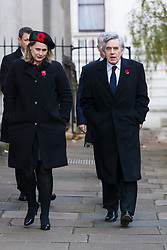 © Licensed to London News Pictures. 10/11/2019. London, UK. Former Prime Minister, Gordon Brown walks through Downing Street with his wife Sarah to attend the Remembrance Sunday Ceremony at the Cenotaph in Whitehall. Remembrance Sunday events are held across the country today as the UK remembers and honours those who have sacrificed themselves in two world wars and other conflicts. Photo credit: Vickie Flores/LNP
