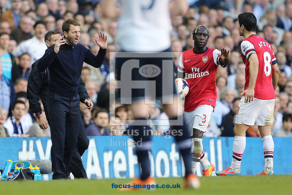 Manager of Tottenham Hotspur, Tim Sherwood reacts to Mikel Arteta and Bacary Sagna of Arsenal during the  Barclays Premier League match from Tomas Rosicky (out of picture) at White Hart Lane, London<br /> Picture by Richard Calver/Focus Images Ltd +447792 981244<br /> 16/03/2014