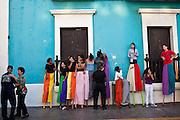 Stilt walkers prepare before parading through the streets of Old San Juan during the Festival of San Sebastian in San Juan, Puerto Rico.