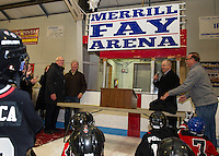 "Merrill Fay is congratulated by Bruce Crowder just moments after they unveil the banner in his honor naming the ""Merrill Fay Arena"" Friday evening.  (Karen Bobotas/for the Laconia Daily Sun)"