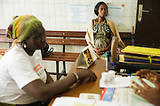 Marielle Gnabrayou Digbeto, 28, waits during a counseling session at the Koumassi general hospital in Abidjan Cote d'Ivoire on Friday July 19, 2013. Marielle is pregnant with her first child and HIV positive.