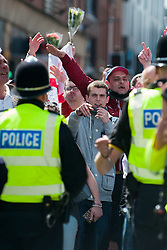 An EDL (English Defence League) organised event to lay flowers at Barkers Pool War Memorial Sheffield,  in memory of Drummer Lee Rigby, resulted in a two hour stand off when Sheffield Unite Against Fascism and One Sheffield Many Cultures supporters occupied Barkers Pool and surrounded the War Memorial leaving police to keep the opposing factions apart. <br /> EDL supporters behind the police cordon<br /> 1 June 2013