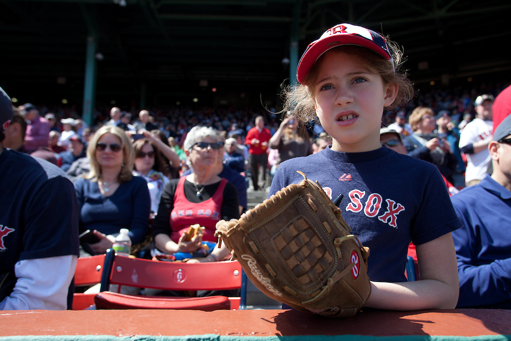 8 Year old Tess Mooney awaits the start of a game between the Boston Red Sox and the Tampa Bay Rays at Fenway Park in Boston, Massachusetts, USA on 13 April 2012. The game marks the season home opener for the Red Sox who have won just one game so far this year.