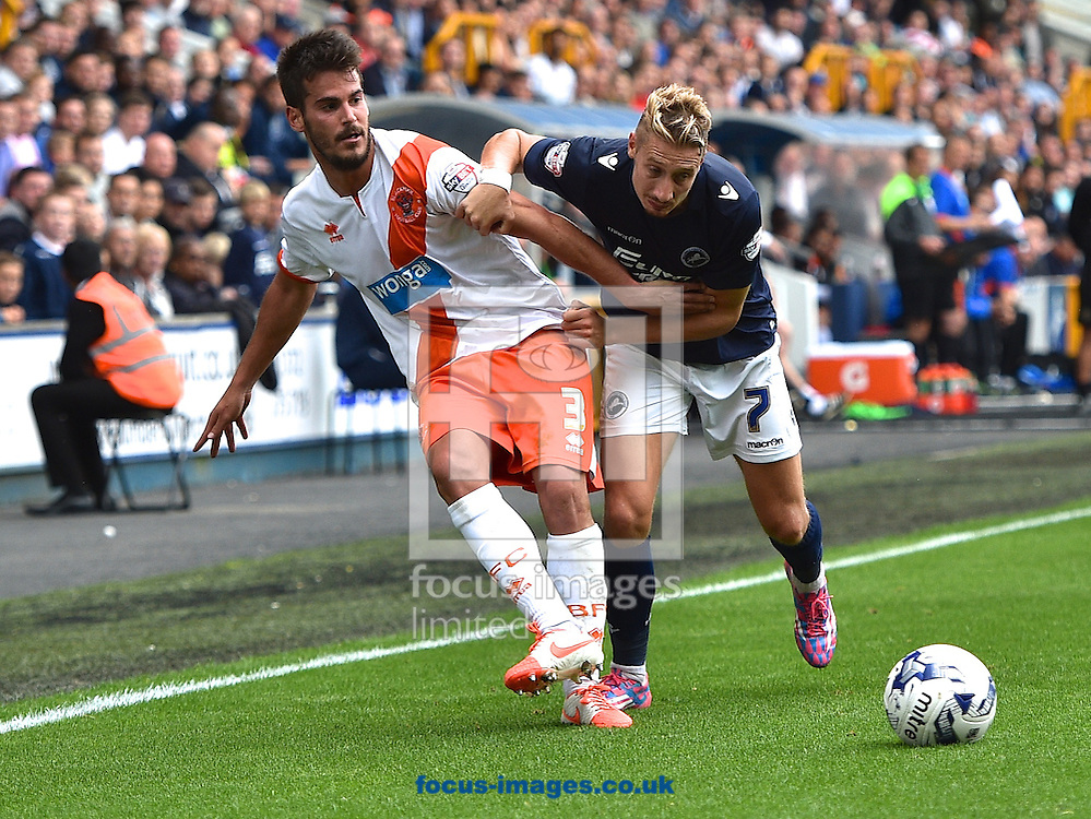 Lee Martin of Millwall and Joan Oriol of Blackpool tussle for the ball during the Sky Bet Championship match at The Den, London<br /> Picture by Alan Stanford/Focus Images Ltd +44 7915 056117<br /> 30/08/2014