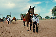 Young cowboy at horse show in Oklahoma, <br /> MODEL RELEASED ON BOY IN FRONT ONLY