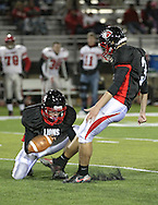 Linn-Mar's Austin Wolter (3) kicks a field goal from the hold of Matt Ramsey (12) during during the game between the Iowa City High Little Hawks and the Linn-Mar Lions at Linn-Mar Stadium in Marion on Friday October 12, 2012.