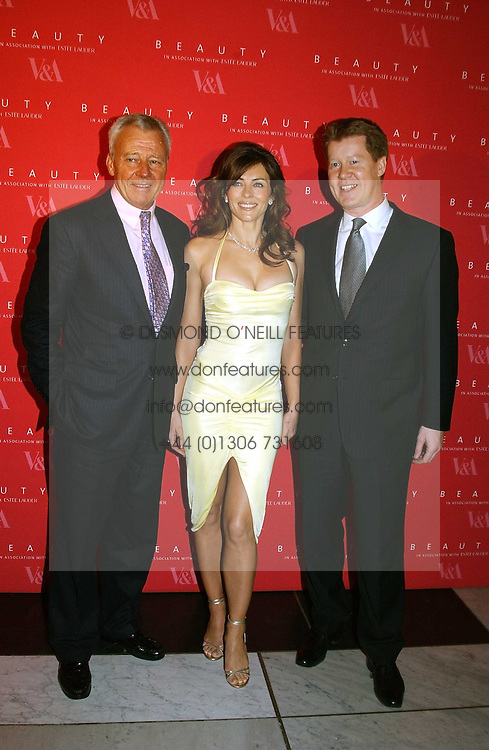 Left to right, PER NEUMAN MD of Estee Lauder, LIZ HURLEY wearing a Versace dress and Jimmy Choo shoes and STEPHEN LINDT at a party to launch 'Beauty Week' at the V&A in association with Estee Lauder- a special week of debates, talks and performances celebrating beauty on 24th January 2005.<br />