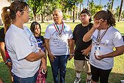 21 JUNE 2012 - PHOENIX, AZ:  PETRA FALCONE (center) talks to other members of PAZ about the Supreme Court's pending US v. Arizona decision in front of the State Capitol Thursday. About 40 people, members of the immigrant rights' group Promise AZ (PAZ), gathered at the Capitol in Phoenix to wait for the US Supreme Court decision on SB 1070, Arizona's controversial anti-immigrant law, in the case US v. Arizona. The court's ruling is expected sometime later this month. Members of PAZ said they would continue their vigil until the ruling was issued.       PHOTO BY JACK KURTZ