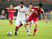 Zheng Zhi of China, right, challenges Nestor Ortigoza of Paraguay during a friendly football match in Changsha city, central China's Hunan province, 14 October 2014.<br /> <br /> Paraguay's dismal run of form continued as they suffered a 2-1 friendly defeat to China on Tuesday (14 October 2014). The South American nation, who came into the game having won two of their previous 13 fixtures, fell short in their bid to pull off a late comeback at Changsha's Helong Stadium. In contrast to their opponents, China have now lost just two of their last 16 matches as they continue to build towards next year's AFC Asian Cup in Australia.