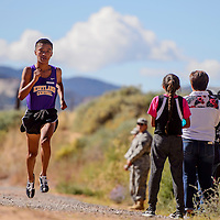 Kirtland Central Bronco Kashon Harrison cruises to a first-place finish during the Gallup Invitational Saturday at Red Rock Park in Gallup.