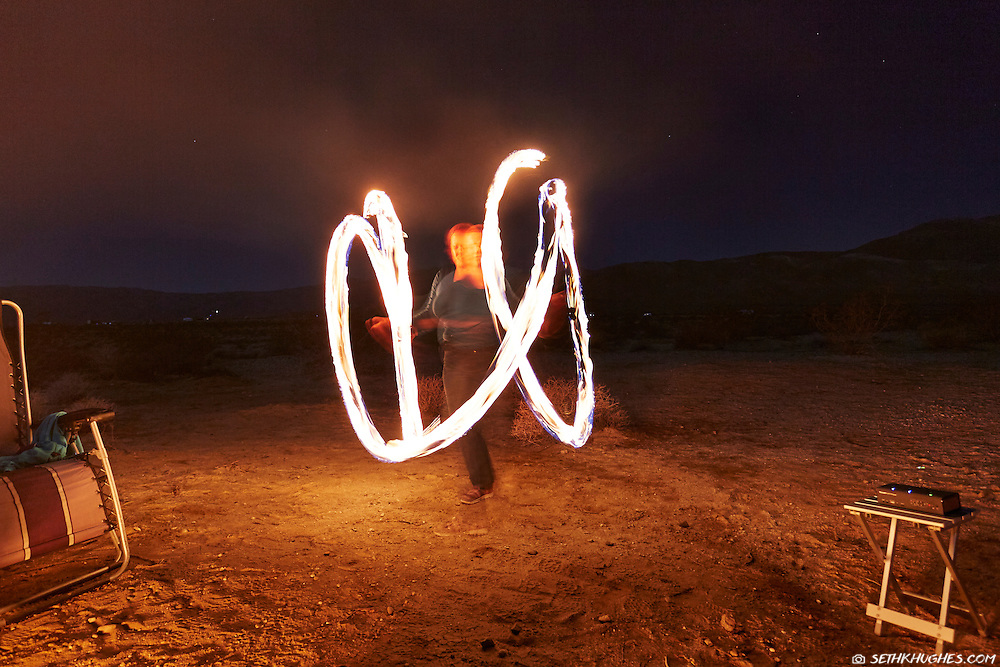 Cherie Ve Ard dances with fire in the Anza Borrego desert of California.