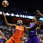 UNCASVILLE, CONNECTICUT- MAY 26:  Chiney Ogwumike #13 of the Connecticut Sun rebounds while challenged by Candace Parker #3 of the Los Angeles Sparks during the Los Angeles Sparks Vs Connecticut Sun, WNBA regular season game at Mohegan Sun Arena on May 26, 2016 in Uncasville, Connecticut. (Photo by Tim Clayton/Corbis via Getty Images)