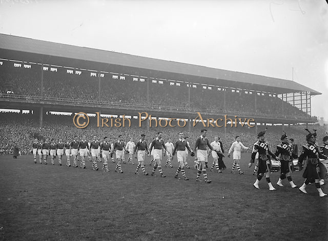 Players line out onto the pitch accompanied by a band before the All Ireland Senior Gaelic Football Championship Final, Cork v Galway in Croke Park on the 7th October 1956. Galway 2-13 Cork 3-7.