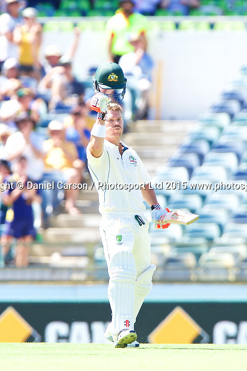David Warner of Australia celebrates his century and 100th run during Day 1 on the 13th of November 2015. The New Zealand Black Caps tour of Australia, 2nd test at the WACA ground in Perth, 13 - 17th of November 2015.   Photo: Daniel Carson / www.photosport.nz