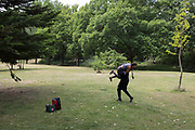A man and his girlfriend mess about in Beckenham Palace Park in south London, on 14th June 2020, in London, England.