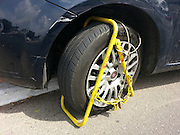 Car wheel clamped for illegal parking