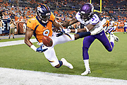 DENVER, CO - AUGUST 11:  John Diarse #9 of the Denver Broncos drops a pass in the end zone while being pushed out of bounds by Holton Hill #37 of the Minnesota Vikings during preseason week 1 at Broncos Stadium at Mile High on August 11, 2018 in Denver, Colorado.  The Vikings defeated the Broncos 42-28.  (Photo by Wesley Hitt/Getty Images) *** Local Caption *** John Diarse; Holton Hill