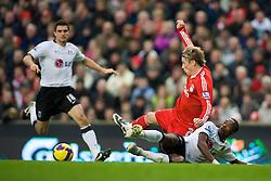 LIVERPOOL, ENGLAND - Saturday, November 22, 2008: Liverpool's Fernando Torres and Fulham's John Pantsil during the Premiership match at Anfield. (Photo by David Rawcliffe/Propaganda)