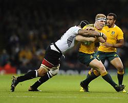 Fiji Number 8 Netani Talei tackles Australia Number 8 David Pocock  - Mandatory byline: Joe Meredith/JMP - 07966386802 - 23/09/2015 - Rugby Union, World Cup - Millenium Stadium -Cardiff,Wales - Australia v Fiji - Rugby World Cup 2015 - Pool A