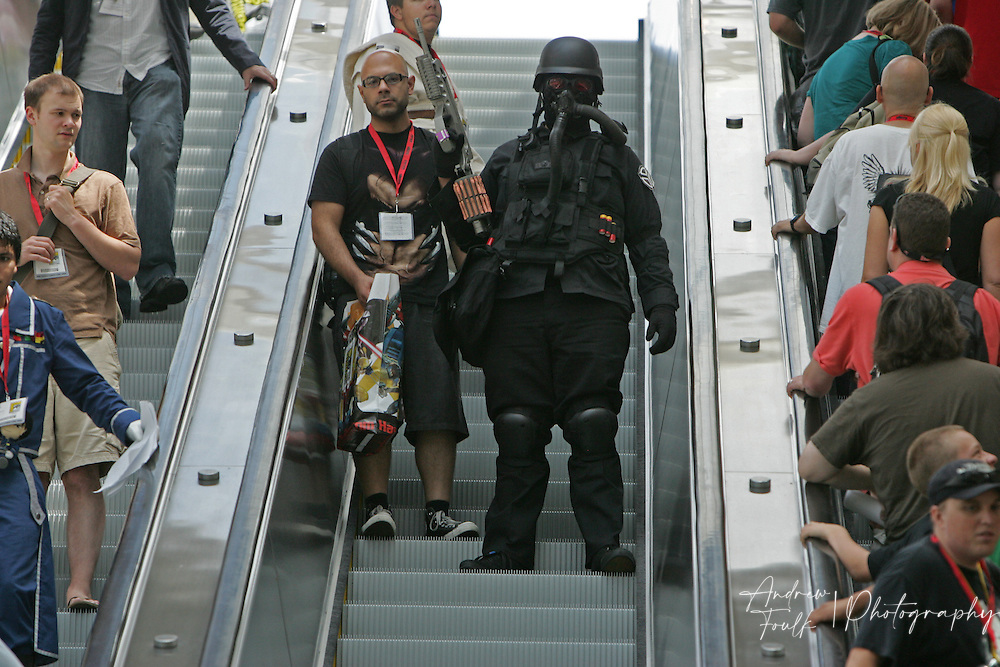 Andrew Foulk/ Zuma Press.July 23, 2009, San Diego, California, USA. Comic Con. A costumed character makes his way down one of the escalators at the San Diego Convention Center, during day one of the 40th annual San Diego International Comic Con.